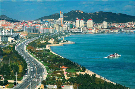 This is Half Moon Bay in Weihai, China.  Our 2-lap, 4K ocean swim will be here.  The latitude is about the same as Seoul, Korea and air and water temperatures are expected to be good.  Air quality looks good in this picture too, no?
