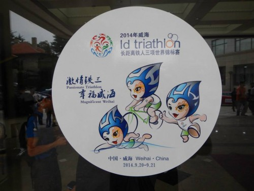 A local competition was held to create a logo for our race.  The winner was a raindrop named Wei Wei, shown swimming, biking and running.