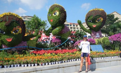 Here's Wei Wei in a large floral sculpture.  How cool is that?